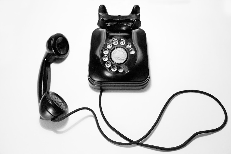 rotary dial phone with handset off cradle