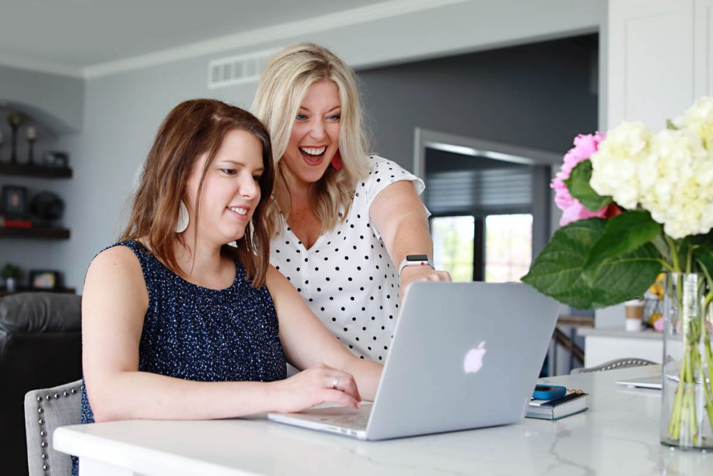 two women looking a a laptop computer