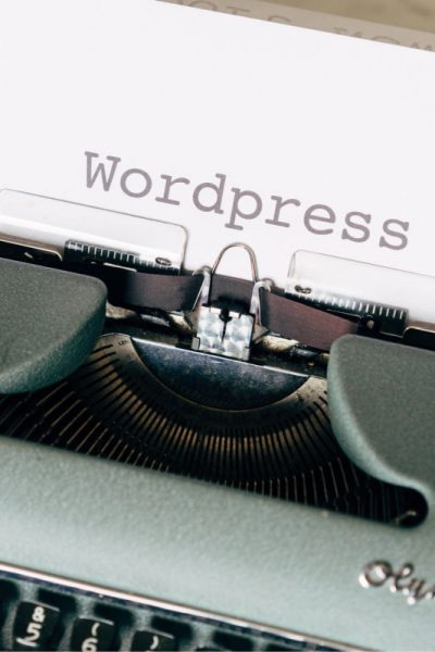 typewriter with piece of paper that says Wordpress