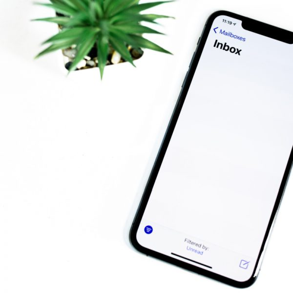 white background with phone screen showing empty email inbox